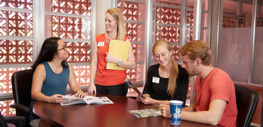 CIU admissions counselors meeting with students in the Visit Room.