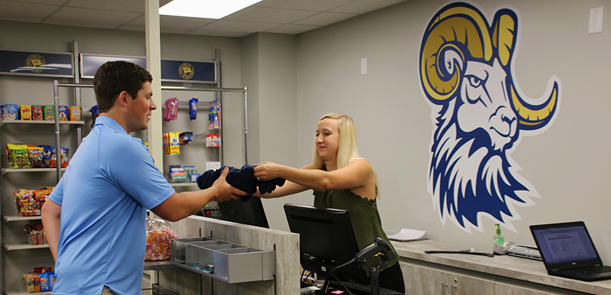 CIU senior Drew Clemmons buys CIU gear from CIU Campus Store Manager Hailey Planck