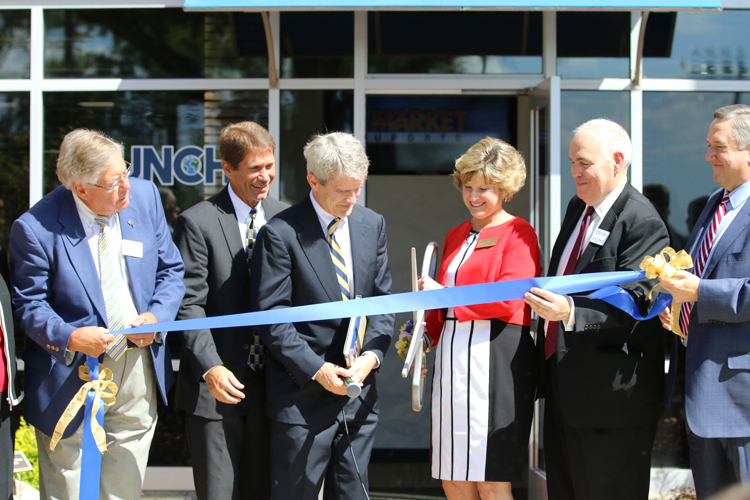Cutting the ribbon at the John R. Cook Jr. Business and Entrepreneurship Center