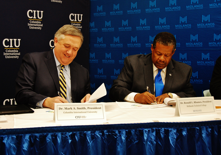 CIU President Dr. Mark Smith (left) and Midlands Technical College President Dr. Ronald Rhames sign agreement.