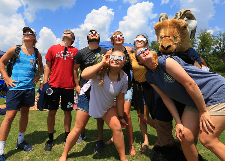 CIU students are joined by the Rams mascot on Sessions Field. (Photo by Seth Berry)