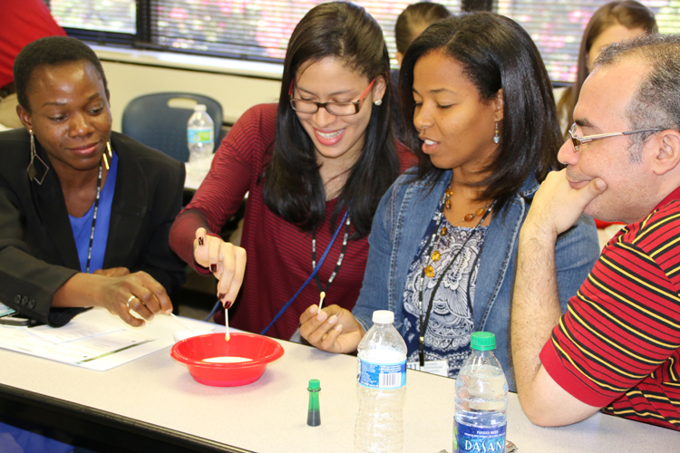 """Christian school educators conduct an experiment at a session on """"Teaching for Inquiry."""""""