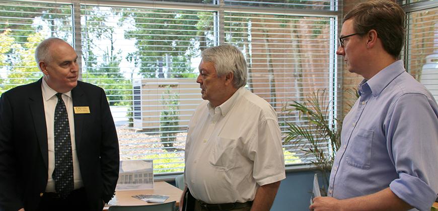 Scott Adams with Jim Byrum and Dickson Monk.