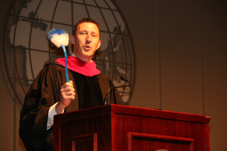 CIU commencement speaker Dr. Jeff Philpott makes a point about being a servant during his commencement address.