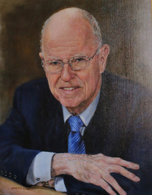Portrait of Robertson McQuilkin hangs in the entryway of the McQuilkin Building on the CIU campus.