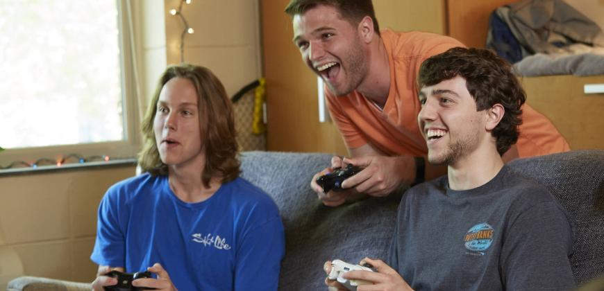 CIU students playing video games in the residence hall.