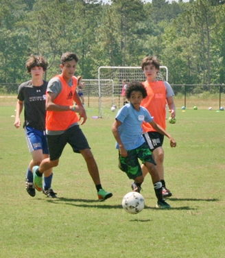 Dribbling the ball on the CIU soccer field