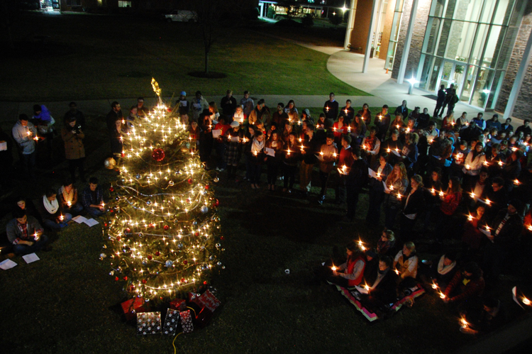CIU students sing carols as the Christmas tree is lit.