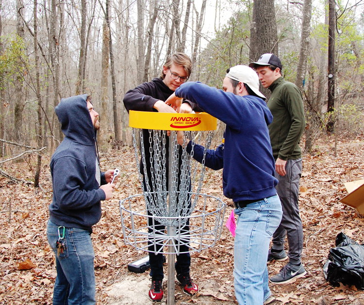 Setting up for disc golf on the CIU campus.