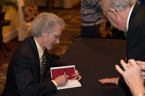Philip Yancey signs one of his books after the banquet.