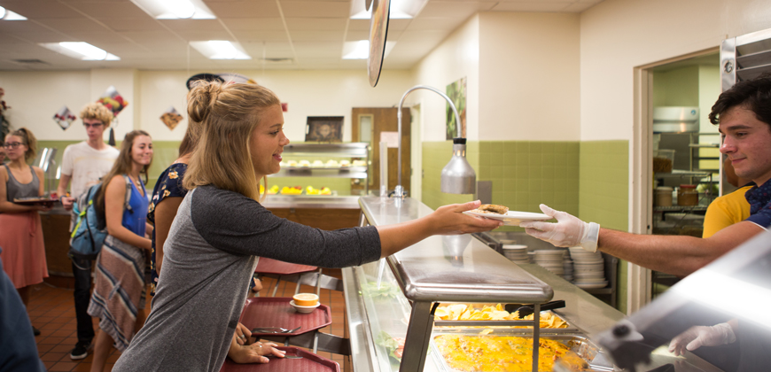 CIU students in the cafeteria line for lunch.