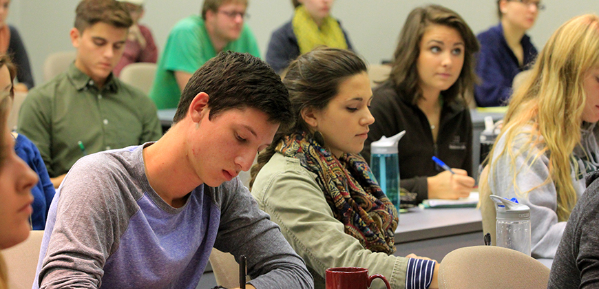 CIU students taking notes during class.