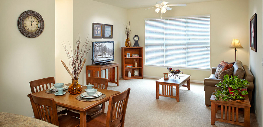 A photo of the living room and dining room at Pine View apartments on the campus of CIU.