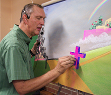 A photo of Paul Young, CIU alumnus, drawing.