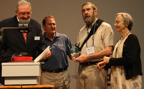 Dr. Jack Layman receives Kingdom Impact Award. Left to right: Director of CIU Al