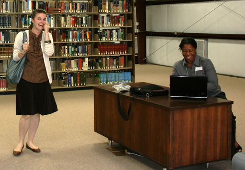 Student Elizabeth Gross (left) expresses delight as librarian Stephanie Solomon