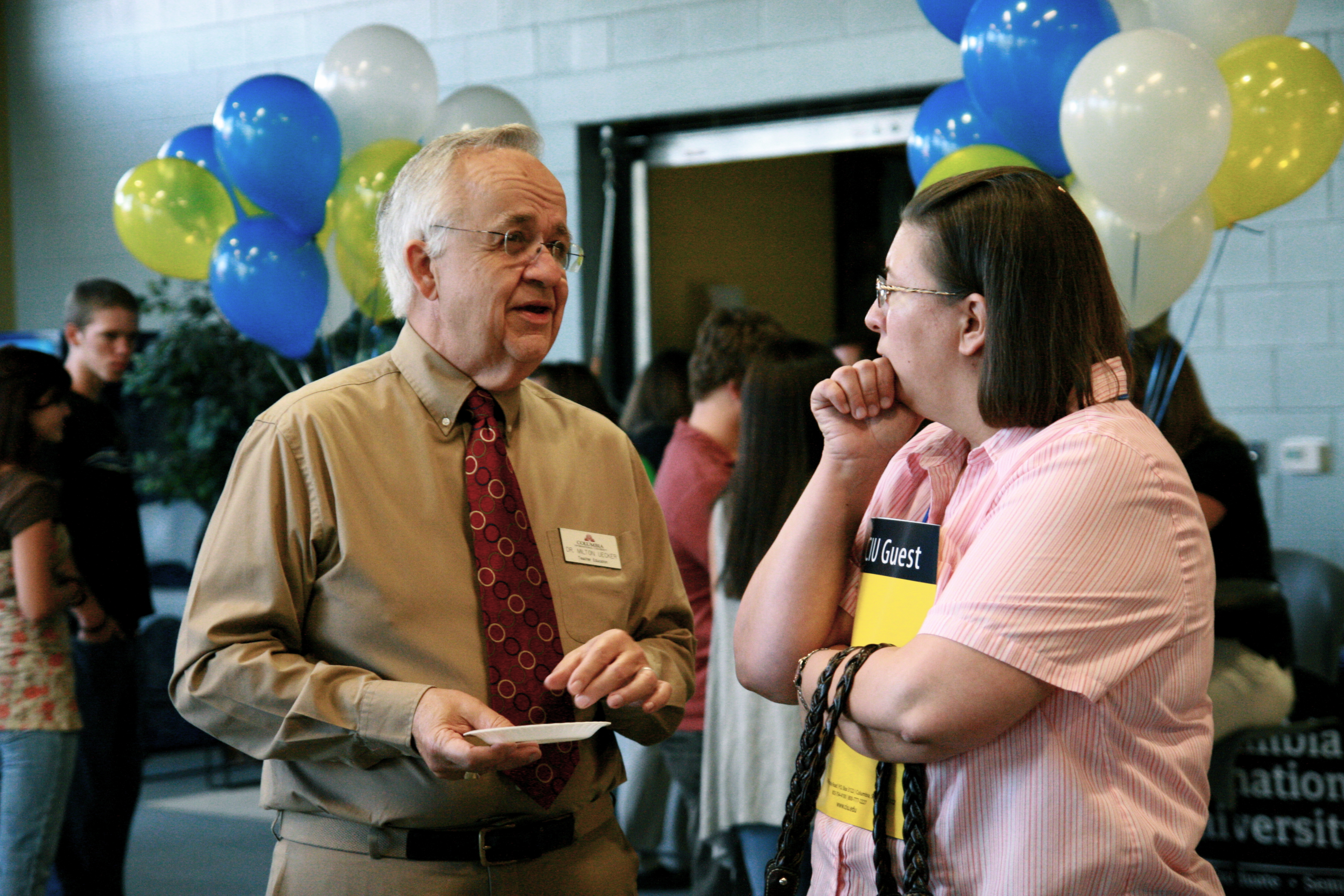 CIU Associate Dean of the School of Education, Dr. Milt Uecker (left), discusses