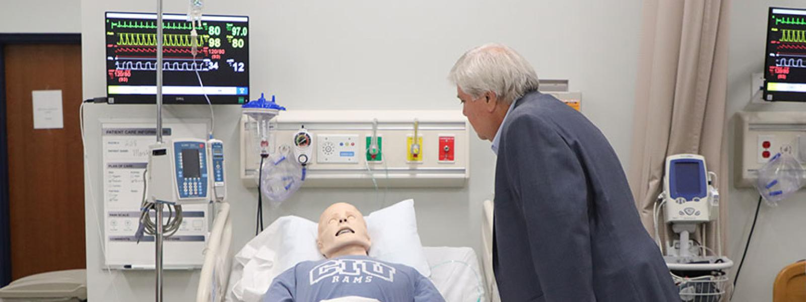 """A """"patient"""" gets a visitor in the Simulation Room. (Photos by Kierston Smith)"""