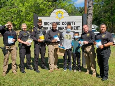 CIU Seminary student Tiepeng  Lyu and his son Thomas deliver masks to the Richland County Sheriff's Department (Photo provided
