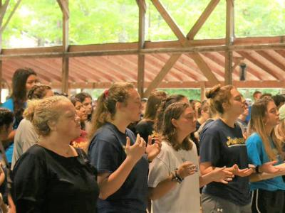 Athletes and coaches worship in song at the retreat