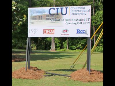 The sign announcing the construction of the William H. Jones Global Business & IT Center