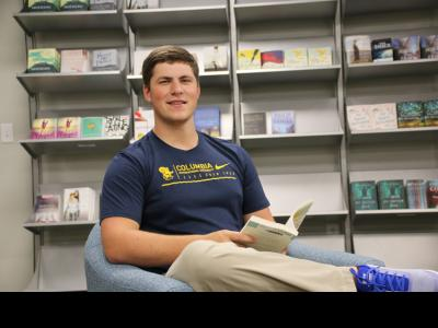 Drew Clemmons, a CIU senior enjoys a book in the CIU Campus Store.