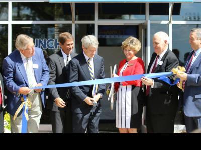 Cutting the ribbon at the John R. Cook Jr. Business and Entrepreneurship Center
