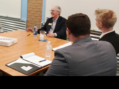 Former Krispy Kreme CEO James Morgan with CIU Business students.