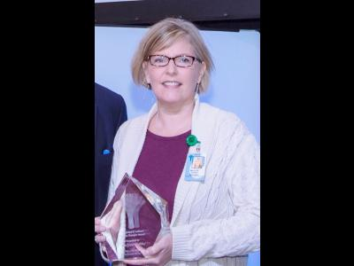 Marjorie Hobbs holding the Lead by Example Award