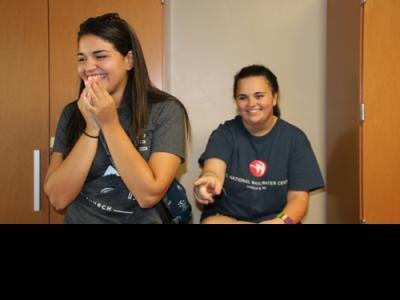 Columbia International University roommates Emily Hernandez (left) and Emily Wood discuss room arrangements.