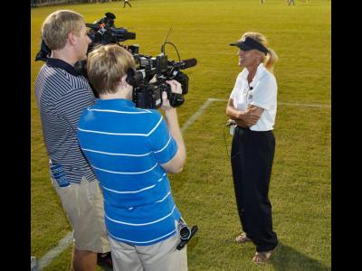 Kim Abbott talks to the media in 2012.
