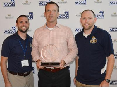 Athletic Director James Whitaker, Men's Basketball Head Coach Marshall Tague, and Cross Country/Track & Field Head Coach Jud Brooker with the Sport Ministry trophy.