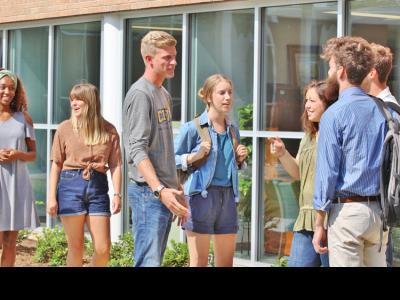 CIU students chat outside the renovated Fisher Building.
