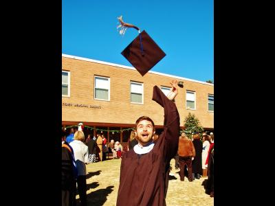 Timothy Wolff celebrates after earning his master's degree in Teaching English as a Foreign Language/Intercultural Studies