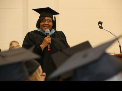 Peggie Johnson speaks to graduates of the CIU Prison Initiative