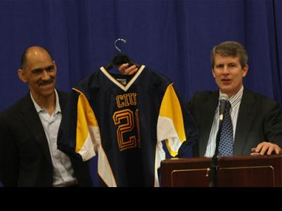 CIU President Bill Jones (right) presents Tony Dungy with a CIU athletic jersey.