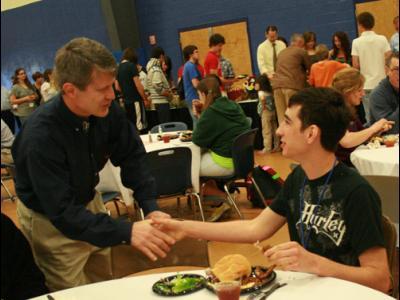 CIU President Bill Jones (left) greets a guest at Preview Days.