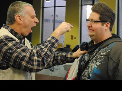 """Dr. David Olshine (left) """"counsels"""" Terrace Crawford at the 2010 Youth Ministry"""