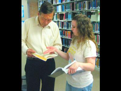 Librarians Helping Patrons: 1st Place. CIU Fleece library staff member helping a