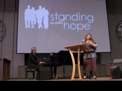 Peter and Gracie Rosenberger address a CIU Chapel Nov. 18.