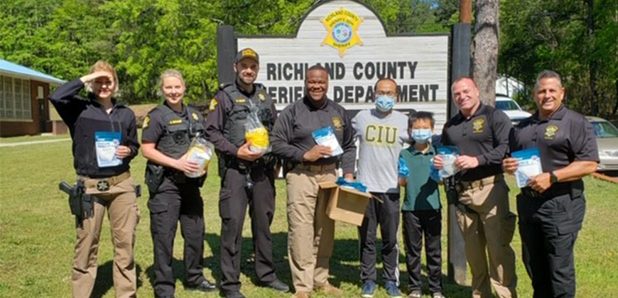 CIU Seminary student Tiepeng  Lyu and his son Thomas deliver M95 masks to the Richland County Sheriff's Department (Photo provided)