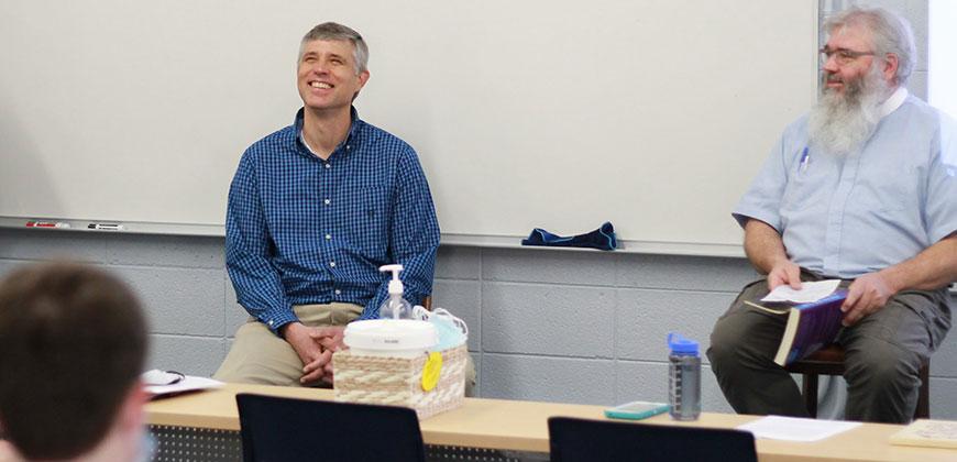 """Dr. Steve Baarendse (left) and Dr. John Crutchfield share a laugh at the """"Tolkien Talks"""""""