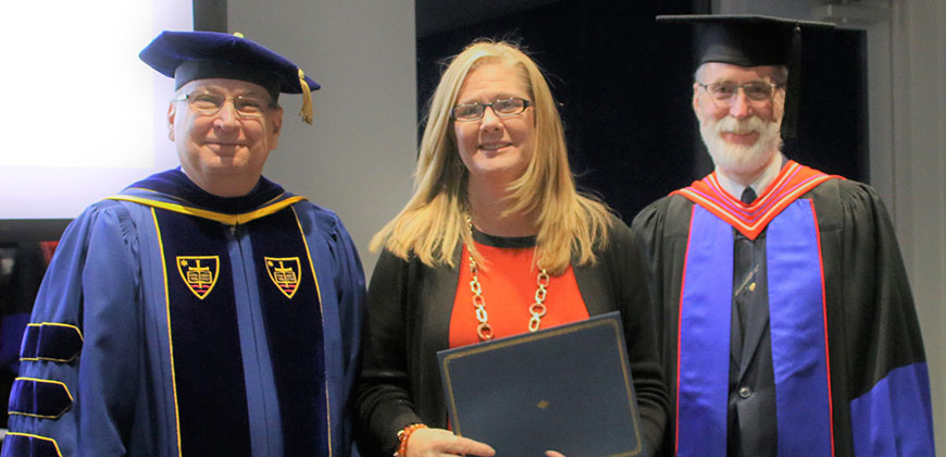 Patricia England celebrates her Diploma in Women's Leadership with Provost Dr. James Lanpher (left) and Dr. John Harvey, dean of the Seminary & School of Ministry.