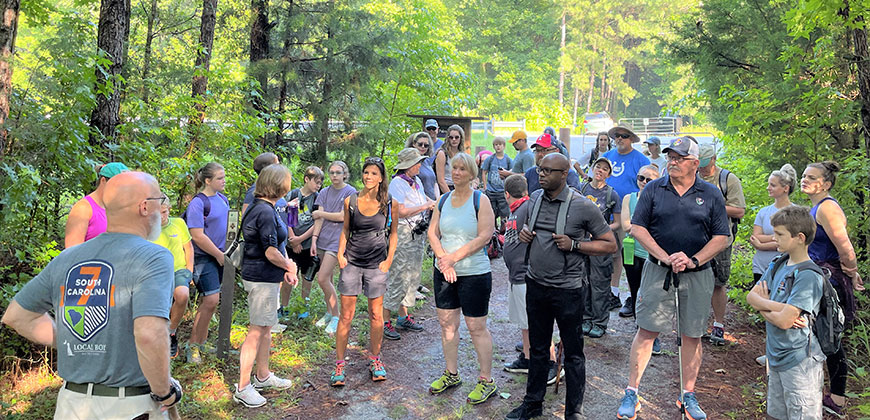 Tom Mullikin addresses the hikers on the Peak to Prosperity Passage.