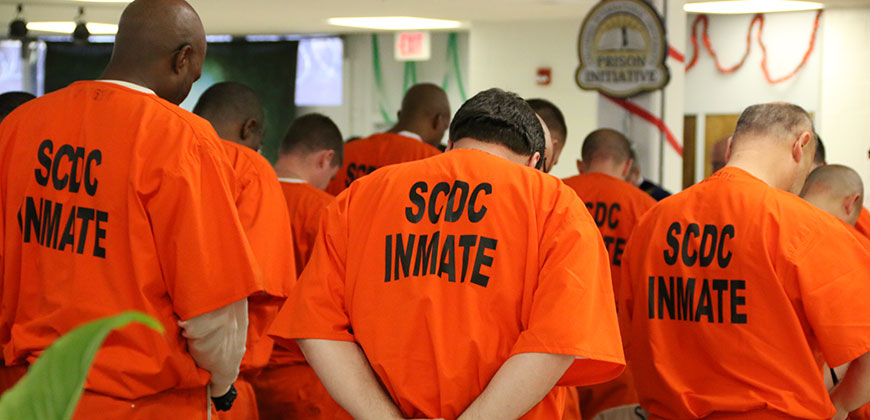 Students enrolled in the CIU Prison Initiative pray at a Prison Initiative commencement held at Kirkland Correctional Institution in Columbia.