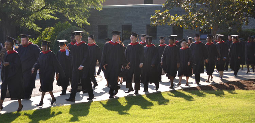 A graduation photo of a CIU grad students. Graduate and seminary students may qualify for scholarships and grants.