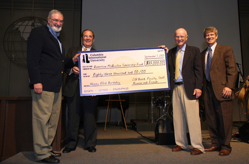 McQuilkin (second from right), is presented with an oversized check for $83,000