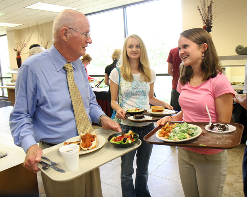Robertson McQuilkin chats with CIU students in the cafeteria.