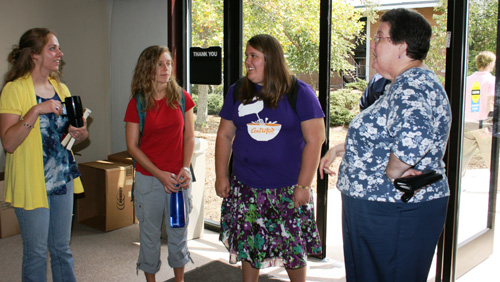 Library Director Jo Ann Rhodes (right) greets students as the door.