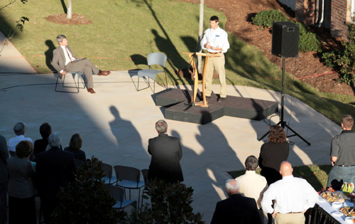 The setting sun casts shadows over the courtyard of Pine View Apartments as CIU